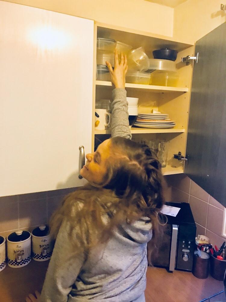 Short girl can't reach top shelf