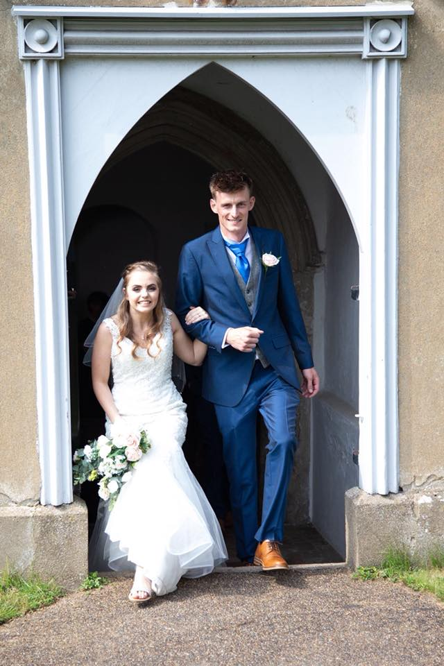 newlyweds coming out of the church