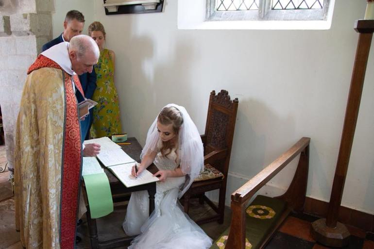 signing the register 2